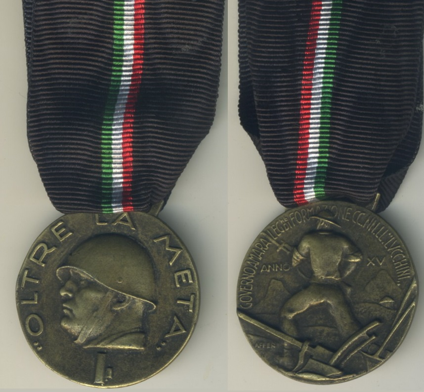 """This unofficial medal is awarded to members of the Legione di Formazione Camicia Nera Lavoratori """"Lucchini"""" (Black Shirt Workers Legion """"Lucchini"""") Oltre La Meta. for their work conducted in Africa Orientale Italiana (Italian East Africa)."""