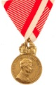 Bronze medal for military merit with war ribbon. Adopted April 18, 1917 with the profile of Emperor Charles. 32 mm