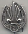 2 REI beret badge, locally made in Tchad, 1979-1980 dimensions 45x35 mm, Trademark stamp Drago on the backside
