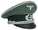 Officer Schirmmutzen Visor Cap in field grey wool with white piping, dark green velvet band, black peak and complete with cap cord, metal cap eagle and oak leaf wreath and cockade insignia.