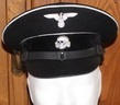 Black Wool Allgemeine Enlisted Man/NCO s Schirmmutzen Visor Cap in black wool with white wool piping, leather black peak, complete with leather chin strap, eagle and skull badge.