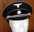 Allgemeine Officers visor cap. Worn by Officers of the Allgemeine SS. Handmade from a heavy black wool with white cotton piping, black peak and complete with cap cord, eagle and skull badge, leather sweatband and silver bullion chin strap.