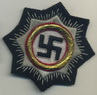 German cross in gold fabric badge.