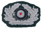 Wehrmacht officers cockade. Hand woven with metallic threads on dark green wool.