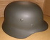 German Wehrmacht green helmet, complete with interior and chin strap. One size adjustable.